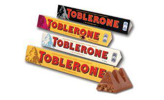 Шоколад молочний, білий,чорний, з горіхом та родзинками Тоблерон 100г